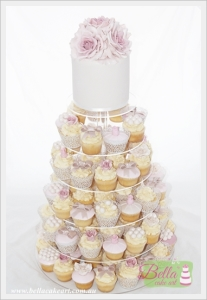 Vintage inspired cupcake tower decorated with hand-made sugar roses. All decorations are hand-made by Bella Cake Art.